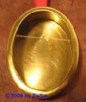 Reliquienkapsel aus Messing oval