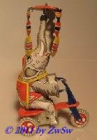 Elefant auf Dreirad